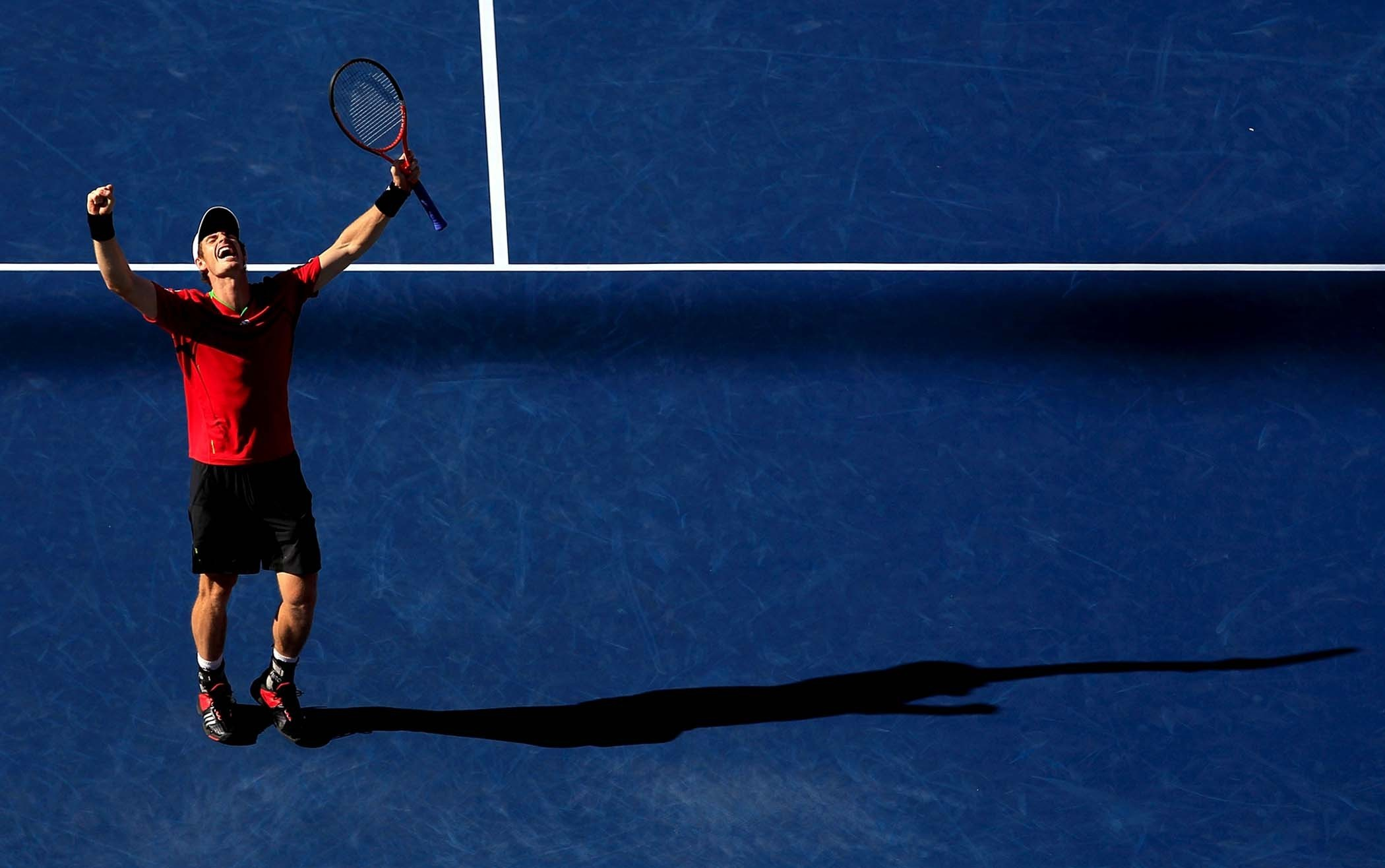 titillating tennis player can't believe the size of his racket  85412